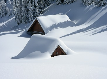 Snow covered roof - roof repair Surrey, Vancouver, Langley, White Rock. Landmark Roofing Experts.